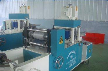 Automatic folding paper napkin embossing machine